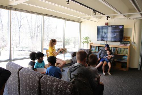 "AAI member high school freshman Sarah Luckenbach reading ""I Am Neil Armstrong"" at story time to children.Photo Credit: Mary Ducca"