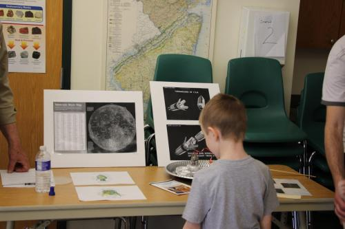 "Child participating in the ""Moon Missions"" activities.Photo Credit: Mary Ducca"